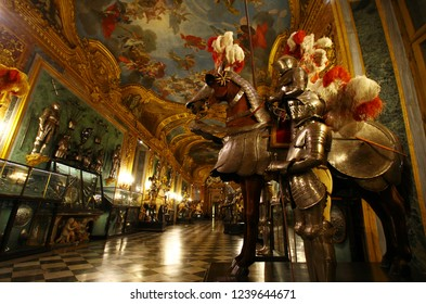 TURIN, ITALY - December 8, 2016: rich luxurious Baroque interiors of Palazzo Reale (historic Royal palace of House of Savoy) with medieval knight armors, ceiling frescoes and huge crystal chandeliers.