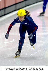 TURIN, ITALY FEBRUARY 16, 2006: Female USA athlete competing during the Short Track competition at the Winter Olympic Games of Turin 2006.