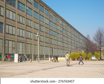 TURIN, ITALY - FEBRUARY 19, 2015: Tourists visiting the Fiat Lingotto car factory designed by Trucco in 1916 now turned into an exhibition centre and shopping mall