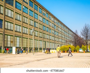TURIN, ITALY - FEBRUARY 19, 2015: Tourists visiting the Fiat Lingotto car factory designed by Trucco in 1916 now turned into an exhibition centre and shopping mall (HDR)