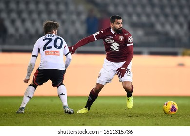 TURIN, ITALY - JANUARY 09, 2020: Tomas Rincon (R) of Torino FC is challenged by Lasse Schone of Genoa CFC during the Coppa Italia football match between Torino FC and Genoa CFC.