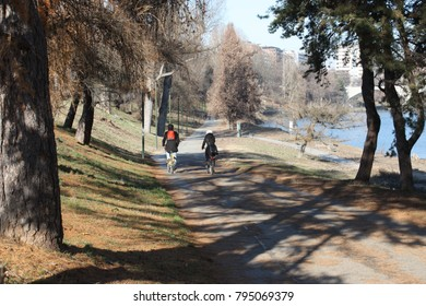 Turin, Italy - January 13, 2018: Many people come to ride a bike on a weekend in the Valentino park in Torino. The people still like to come to the park.