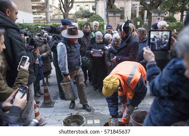TURIN, ITALY - JANUARY 14, 2016: Artist Gunter Demnig lays one of his stumbling blocks at the 'Memory Blocks' performance in Turin, Italy. He started  in 1996 to remember the victims of Nazism.