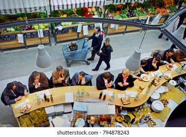 Turin, Italy - January 21, 2014: People inside Eataly high-end Italian food market/mall