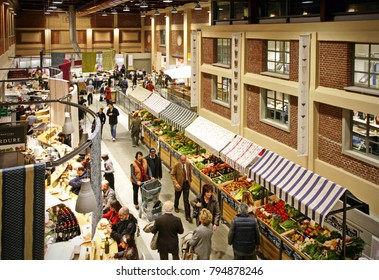 Turin, Italy - January 21, 2014: People inside Eataly shop in Manhattan. Eataly is a high-end Italian food market/mall