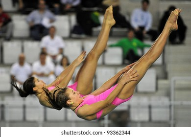 TURIN, ITALY - JANUARY 22: Sara Borghi and Daria Ferretti compete at 3m diving board at 2012 Indoor diving Italian championship on January 22, 2012 in Turin, Italy.