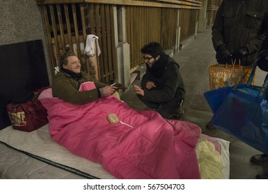 Turin, Italy- January 29, 2017: The Community of Sant'Egidio, every week distributes homeless people bringing them in person prepared hot meals and blankets to help them on the days of blackbird