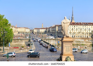 Turin, Italy - July 12, 2019: Monument to Vittorio Emanuele I. The statue of the Supreme Savoy Vittorio Emanuele I (1759-1824). View of the Ponte Vittorio Emanuele I and Piazza Vittorio Veneto