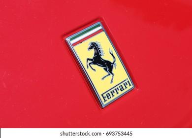 TURIN, ITALY - JUNE 10, 2017: Classic Ferrari logo on a red car body