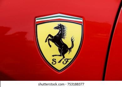 TURIN, ITALY - JUNE 10, 2017: Classic Ferrari logo on a red car body .