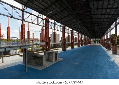 Turin, Italy, June 11, 2011: Former industrial warehouse converted into sports facilities in Parco Dora, a public park built on a former industrial area, preserving some structures of the old plants.