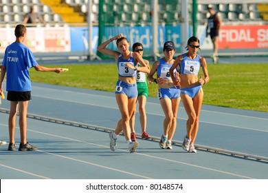 TURIN, ITALY - JUNE 26: 3 FERRARO Federica, 5 GIORDANO Rossella, 6 GIORGI Eleonora Anna run 10km walk at 2011 Summer Track and Field Italian Championship meeting on June 26, 2011 in Turin, Italy.
