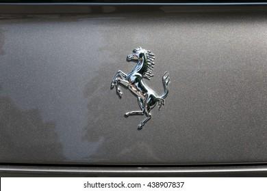TURIN, ITALY - JUNE 9, 2016: Ferrari logo on a grey car model