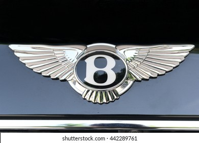 TURIN, ITALY - JUNE 9, 2016: Bentley logo on a dark car body and reflections