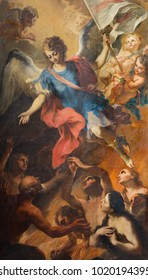 TURIN, ITALY - MARCH 15, 2017: The painting of Archangel Michael and the souls of purgatory in church Chiesa di San Francesco da Paola by Stefano Maria Legnani from end of 18. cent.