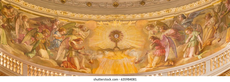 TURIN, ITALY - MARCH 15, 2017: The fresco of Eucharistic adoration of angels in cupola of church Basilica Maria Ausiliatrice by Giuseppe Rollini (1889 - 1891).