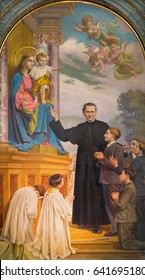 TURIN, ITALY - MARCH 15, 2017: The painting of Don Bosco and Mary Help of Christians in church Basilica Maria Ausiliatrice by Paolo Giovanni Crida (1941).