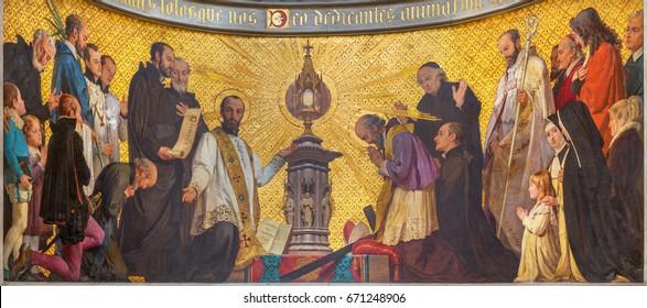 TURIN, ITALY - MARCH 15, 2017: The symbolic fresco of The adoration of holys in front of Eucharist in church Chiesa di San Dalmazzo by Enrico Reffo (1831-1917).