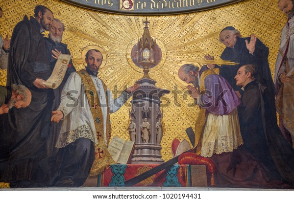 TURIN, ITALY - MARCH 15, 2017: The symbolic fresco of The adoration of holys in front of Eucharist in church Chiesa di San Dalmazzo by Enrico Reffo (1831-1917).