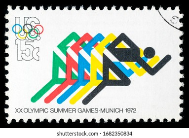 TURIN, ITALY - MARCH 25, 2020: A stamp printed in USA celebrating the 20th Summer Olympics Games held in Munich, Athletics, circa 1972