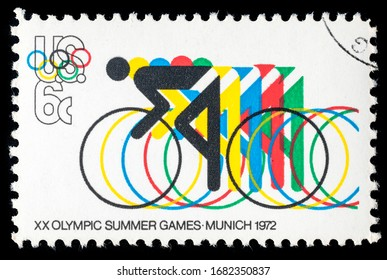 TURIN, ITALY - MARCH 25, 2020: A stamp printed in USA celebrating the 20th Summer Olympics Games held in Munich, Cycling, circa 1972