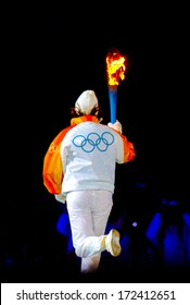 TURIN, ITALY - MARCH 28: The latest torch bearer enters in the stadium during the Opening Cerimony of the Winter Olympic Games in Turin March 28, 2006.