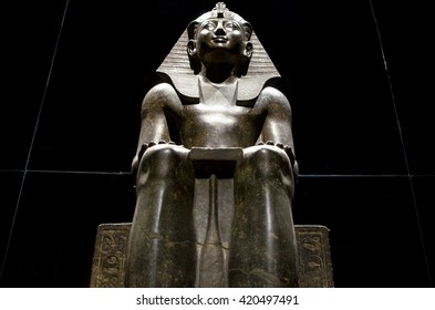 Turin, Italy, March 8 2013: egyptian pharaon statue on display at the Egypt Museum