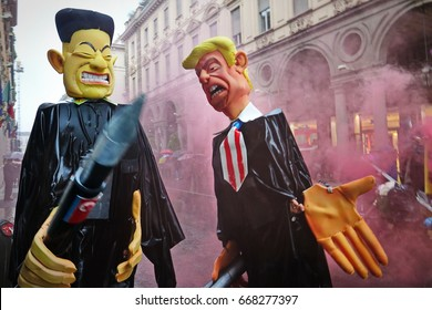 Turin, Italy - May 1, 2017: Puppets of Kim Jong-un and Donald Trump with missiles, Pacifists against the danger of a war between USA and North Korea,  in the parade on May 1 in Turin, Italy