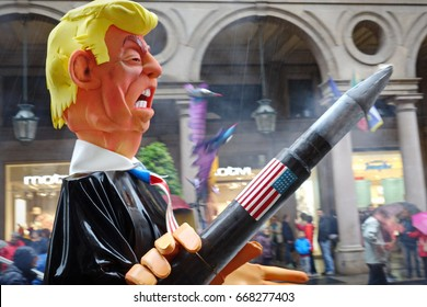 Turin, Italy - May 1, 2017: Puppet of Donald Trump with missiles, Pacifists against the danger of a war between USA and North Korea,  in the parade on May 1 in Turin, Italy