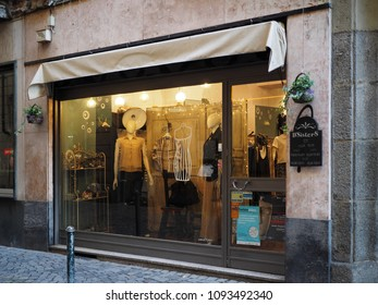 Turin, Italy - May 11, 2018. Shop for women's clothes in the historic center, illuminated showcase.
