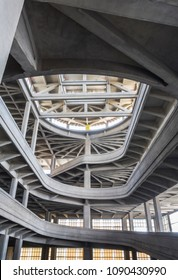 "Turin, Italy - May 12, 2007: The south track of ""Lingotto"", an helicoidal ramp once used to test cars. The old factory of ""Lingotto"" is now devoted to commercial, leisure and cultural activities."