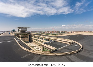 "Turin, Italy - May 12, 2007: The parabolic track on the roof of ""Lingotto"", once used to test cars. The old factory of ""Lingotto"" is now devoted to commercial, leisure and cultural activities."