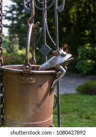 Turin, Italy - May 18, 2015: Valentino Park: detail of an old well with a metal frog in the bucket.