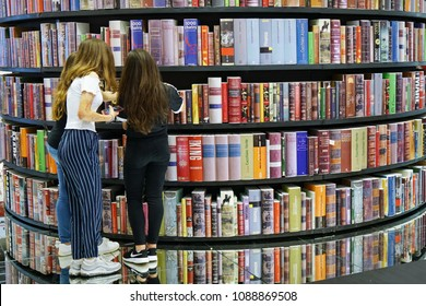 TURIN, ITALY - MAY 18: Teenagers students looking for a book in public library of Turin.
