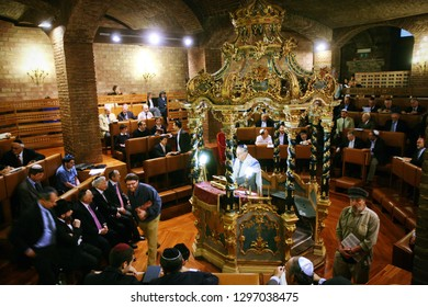 Turin, Italy - May 2014: people praying  in the synagogue of turin