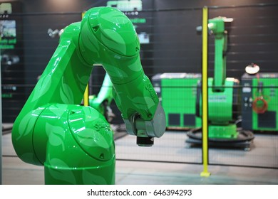 Turin, Italy - May 5, 2017: Green robotic arm with skin texture