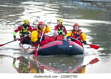 Turin, Italy - november 2016: Flood rescue teams are helping two elderly women out of floods.