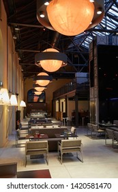 TURIN, ITALY - NOVEMBER 3, 2018: Ogr, Officine Grandi Riparazioni Snodo restaurant interior, evening in Turin, Italy.