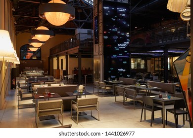 TURIN, ITALY - NOVEMBER 3, 2018: Ogr, Officine Grandi Riparazioni Snodo restaurant interior, evening in Turin, Italy.