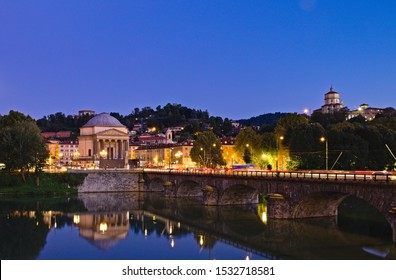 Turin, Italy - October 10, 2019: Night view of the Great Mother (Gran Madre) church in Turin seen across the Po river from Vittorio Veneto square