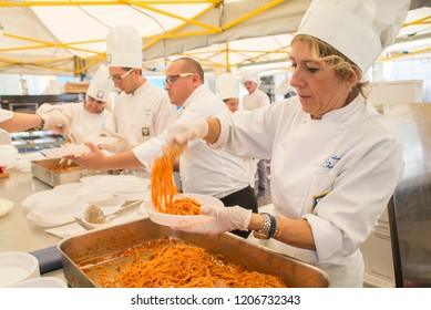Turin, Italy - October 15, 2016: 12 / a National Day of Chefs and Cooks of Turin.The cooks will serve pasta amatriciana and a big cake to charity of the earthquake victims of Amatrice.