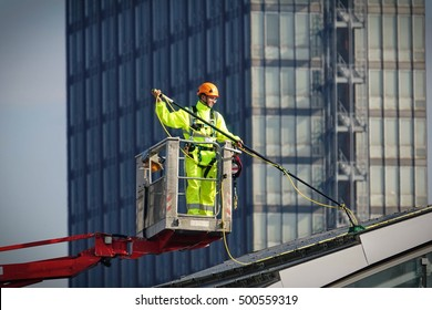 Turin, Italy - October 18, 2016: workers cleaning the photovoltaic panels on a roof