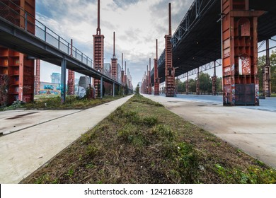 Turin, Italy, October 18, 2018: Parco Dora, a public park built on a former industrial area, preserving some structures of the old plants.