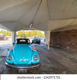 Turin, Italy - October 18, 2018: Blue Beetle under a colonnade in the suburbs.