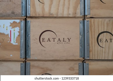 Turin, Italy. October 20018. Wooden boxes with 'Eataly' logo printed on them at Eataly high-end food market in Turin. Eataly opened its first branch in Turin in 2008.