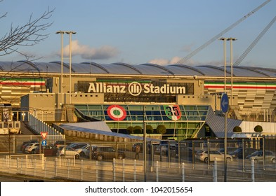 Turin, Italy, Piedmont - March 8 2018 at 18:15 towards sunset. The Allianz Stadium in Turin, former Juventus stadium, main entrance side with the typical white writing.