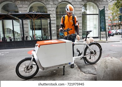 Turin, Italy - September 25, 2017: TNT Postman with his cargo bike
