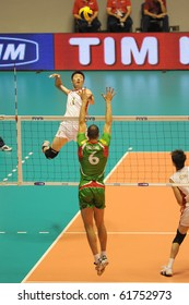 TURIN, ITALY - SEPTEMBER 25: Yuan Zhi (L) strikes the ball during match Bulgaria vs. China First Round of FIVB World Men Volleyball Championship Italia 2010, September 25, 2010 in Turin, Italy.