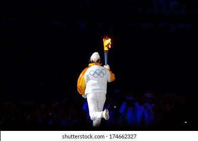 TURIN, ITALY-FEBRUARY 11, 2006: Former skier Deborah Compagnoni, enters at the Olympic stadium, as the last torch bearer, during the opening ceremony of the Winter Olympic Games of Turin 2006.