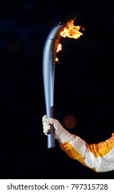 TURIN, ITALY-FEBRUARY 11, 2006: former italian athelete Deborah Compagnoni holds the Olympic torch as she arrives at the Olympic stadium for the opening ceremony of the Winter Olympic Games, in Turin.